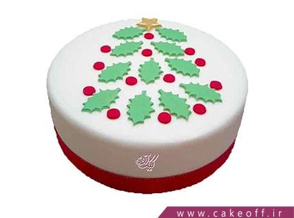 کیک جشن کریسمس در میان برگها | کیک آف